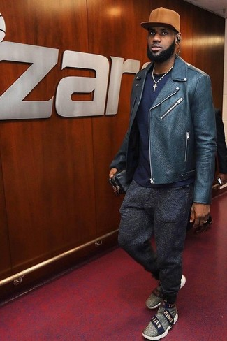 How to wear: navy leather biker jacket, navy crew-neck t-shirt, charcoal wool sweatpants, grey canvas slip-on sneakers