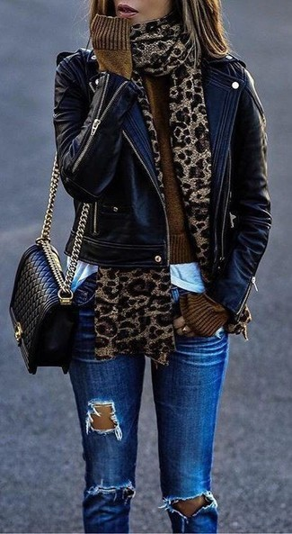 Step up your off-duty look in a black leather moto jacket and blue distressed skinny jeans.