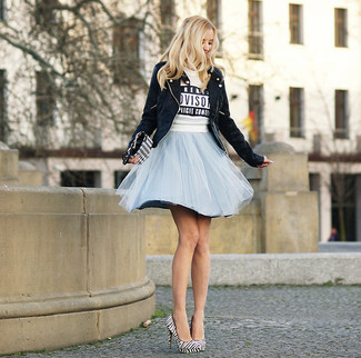 How to wear: black suede biker jacket, white and black print cropped sweater, light blue tulle full skirt, white and black vertical striped leather pumps