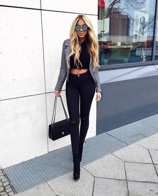 How to wear: grey leather biker jacket, black cropped sweater, black ripped skinny jeans, black suede ankle boots
