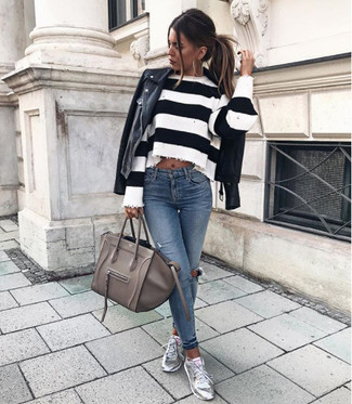 How to wear: black leather biker jacket, white and black horizontal striped cropped sweater, blue ripped skinny jeans, silver leather low top sneakers