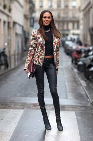 Consider teaming a black floral leather jacket with black leather slim pants for a Sunday lunch with friends. Black leather ankle boots will add a touch of polish to an otherwise low-key look.