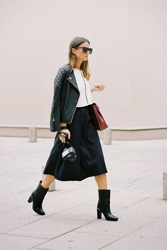 Choose a black quilted leather biker jacket and a black full skirt to effortlessly deal with whatever this day throws at you. Black leather mid-calf boots will add a touch of polish to an otherwise low-key look.