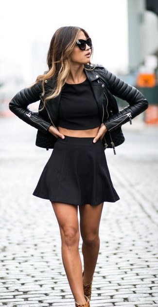 Consider teaming a black cropped top with a black skater skirt for a relaxed take on day-to-day wear. Rock a pair of camel leopard suede booties to va-va-voom your outfit.
