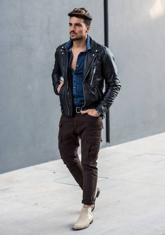 For an on-trend look without the need to sacrifice on practicality, we love this combination of a black leather biker jacket and a black leather belt. Play down the casualness of your getup with beige suede chelsea boots. You can bet this ensemble is great come fall.