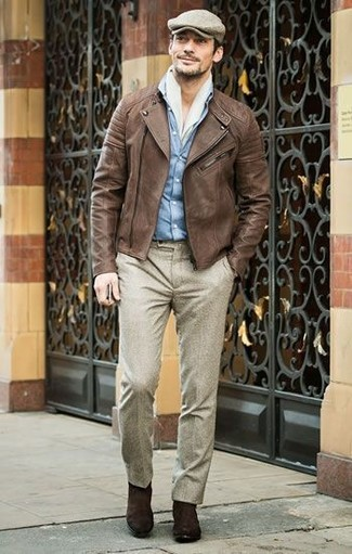 How to wear: brown leather biker jacket, light blue denim shirt, beige wool dress pants, dark brown suede chelsea boots