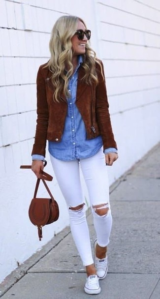 How to wear: brown suede biker jacket, light blue denim shirt, white ripped skinny jeans, white canvas low top sneakers