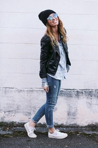 Opt for a black leather moto jacket and blue slim jeans for both chic and easy-to-wear look. White canvas low top sneakers will give your look an on-trend feel.