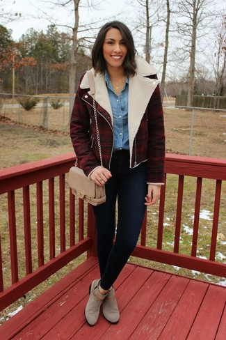 A dark red plaid moto jacket and navy blue slim jeans will give off this very sexy and chic vibe. Make grey suede ankle boots your footwear choice to va-va-voom your outfit.