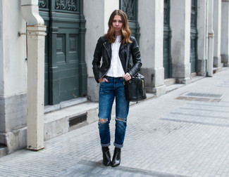 Marry a black quilted leather moto jacket with navy destroyed boyfriend jeans for a casual coffee run. Black leather booties will add a touch of polish to an otherwise low-key look.