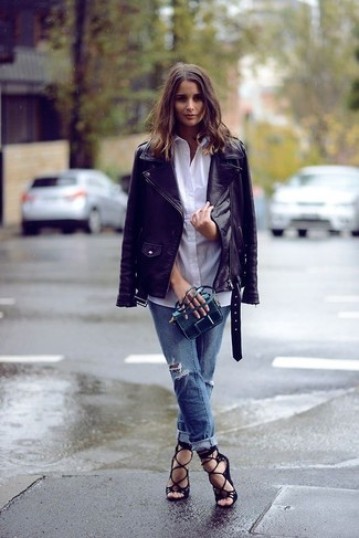 Something as simple as opting for a black leather biker jacket and blue ripped boyfriend jeans can potentially set you apart from the crowd. Finish off your look with black suede gladiator sandals.