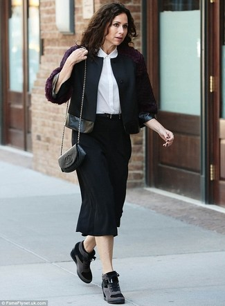 How to wear: black wool biker jacket, white silk dress shirt, black midi skirt, black suede wedge sneakers