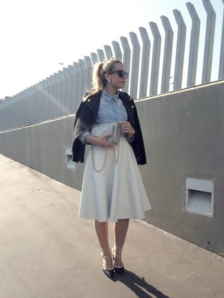How to wear: black biker jacket, light blue chambray dress shirt, white pleated midi skirt, black studded leather pumps