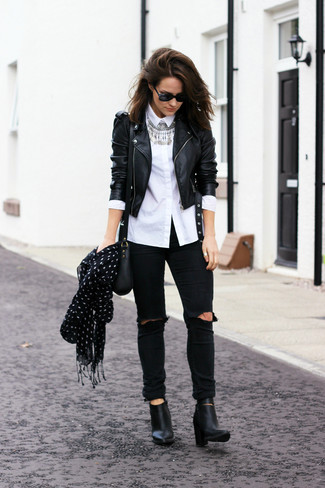 How to wear: black leather biker jacket, white dress shirt, black ripped skinny jeans, black leather ankle boots