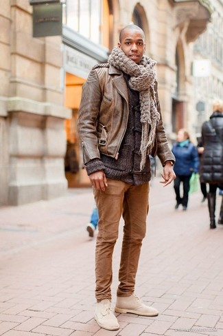 Wear a brown leather moto jacket and brown chinos to get a laid-back yet stylish look. Turn your sartorial beast mode on and opt for a pair of beige suede chukka boots.
