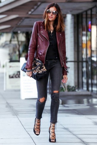 How to wear: burgundy leather biker jacket, black henley shirt, charcoal ripped skinny jeans, black suede gladiator sandals
