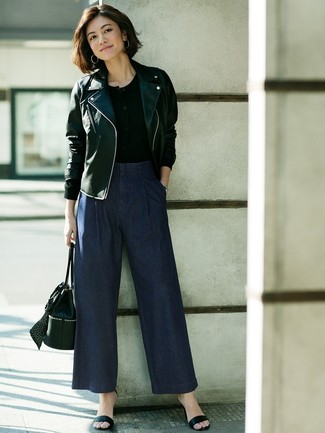 How to Wear Navy Denim Wide Leg Pants: This combination of a black leather biker jacket and navy denim wide leg pants delivers comfort and functionality and helps keep it simple yet current. Give your look an extra dose of elegance with a pair of black leather heeled sandals.
