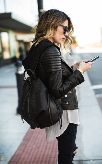 A black quilted leather motorcycle jacket and black destroyed slim jeans is a savvy combination to carry you throughout the day.