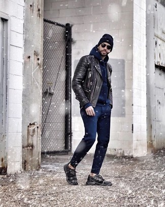How to Wear a Black Leather Biker Jacket For Men: This casual combo of a black leather biker jacket and navy chinos is very easy to put together in no time flat, helping you look awesome and prepared for anything without spending a ton of time rummaging through your wardrobe. A trendy pair of black athletic shoes is the simplest way to add a confident kick to the outfit.