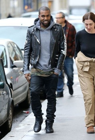 Kanye West wearing Black Leather Biker Jacket, Grey Hoodie, Olive Camouflage Crew-neck T-shirt, Black Jeans