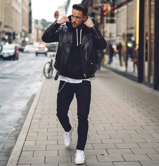 How to wear: black leather biker jacket, black hoodie, white crew-neck t-shirt, black skinny jeans