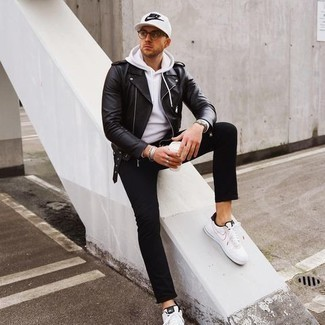 Black Jeans Spring Outfits For Men: A black leather biker jacket and black jeans are absolute menswear must-haves that will integrate really well within your casual routine. A pair of white and black canvas low top sneakers is a savvy option to complement this ensemble. This is a never-failing option for a neat look that transitions easily into spring.