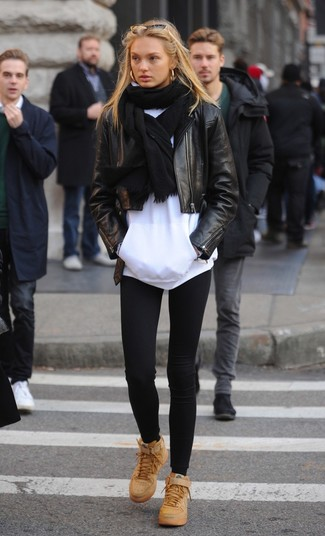 How to wear: black leather biker jacket, white hoodie, black leggings, tan leather high top sneakers