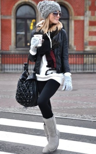 Show off your playful side in a black leather biker jacket and black leggings. A pair of grey uggs ads edginess to a femme classic. You can bet this ensemble will become your go-to when cooler days are here.