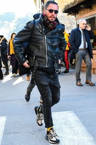 How to wear: black leather biker jacket, black hoodie, black skinny jeans, black and white athletic shoes