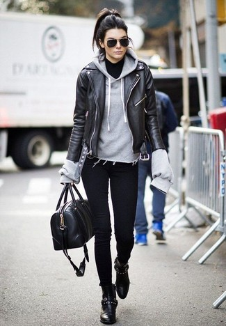 How to wear: black leather biker jacket, grey hoodie, black turtleneck, black skinny jeans