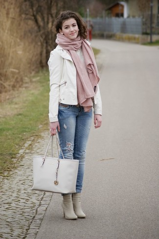 How to wear: white leather biker jacket, light blue jeans, grey leather ankle boots, white leather tote bag