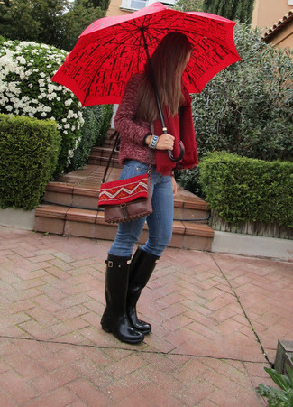 A dark red boucle biker jacket and blue jeans is a versatile combo that will provide you with variety. Want to go easy on the shoe front? Choose a pair of rain boots for the day. On not-so-bone-chilling afternoons, you can sport this transitional getup and look absolutely amazing.