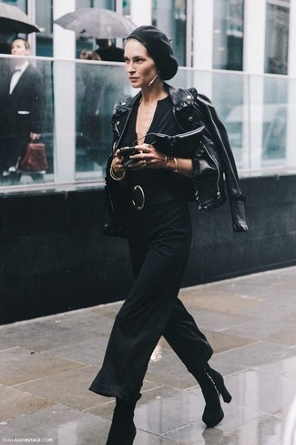 Let everyone know that you know a thing or two about style in a black leather biker jacket and a black jumpsuit. A cool pair of black suede booties is an easy way to upgrade your look.