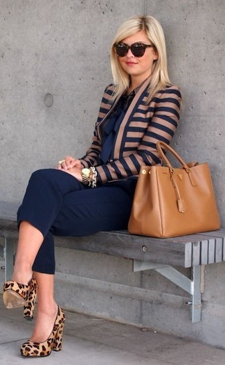 A deep blue horizontal striped biker jacket and capri pants is a good combo to impress your crush on a date night. Camel animal suede pumps will add elegance to an otherwise simple look. We promise this combo is the answer to all of your transeasonal wear woes.