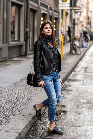 How to wear: black leather biker jacket, black and white print long sleeve blouse, blue ripped jeans, black leather loafers