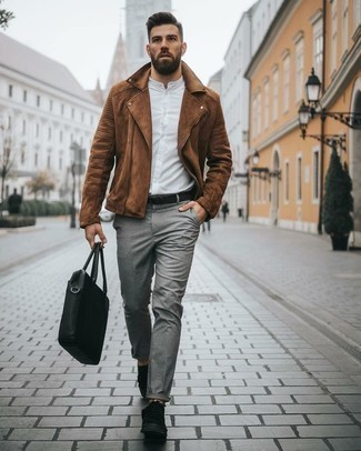 How to Wear a Black Canvas Tote Bag For Men: Reach for a brown suede biker jacket and a black canvas tote bag to achieve a really dapper and relaxed outfit. Let your sartorial skills really shine by finishing off your getup with black canvas low top sneakers.