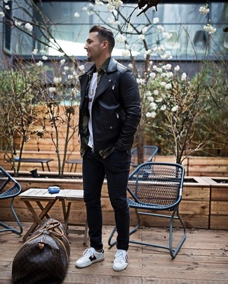 How to Wear a Brown Leather Holdall In Chill Weather Casually For Men: A black leather biker jacket and a brown leather holdall are a smart pairing that will take you throughout the day and into the night. A pair of white and black leather low top sneakers instantly ups the style factor of your getup.