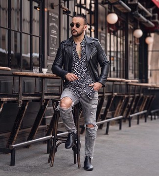 How to wear: black leather biker jacket, black and white print long sleeve shirt, grey ripped jeans, black leather chelsea boots