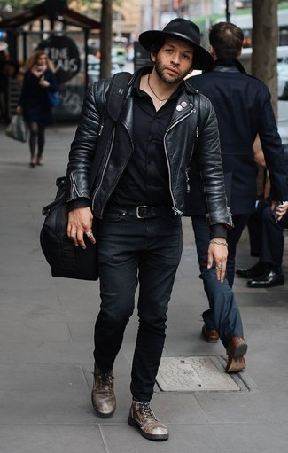 How to Wear Black Jeans For Men: This laid-back combination of a black leather biker jacket and black jeans is extremely easy to pull together without a second thought, helping you look awesome and ready for anything without spending too much time combing through your wardrobe. To introduce a bit of classiness to this getup, complete your look with a pair of dark brown leather casual boots.