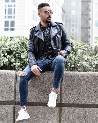 How to wear: black leather biker jacket, navy print long sleeve shirt, blue ripped skinny jeans, white low top sneakers