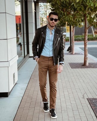 500+ Chill Weather Outfits For Men: Combining a dark brown leather biker jacket with brown chinos is a good choice for a casually dapper outfit. Complement your ensemble with dark brown leather low top sneakers and ta-da: your ensemble is complete.