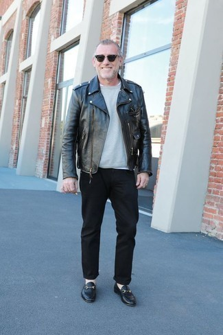 How to Wear Black Leather Loafers For Men: For a laid-back and cool look, marry a black leather biker jacket with black chinos — these two pieces go really well together. And if you need to immediately up the style ante of your look with one single item, complete your outfit with black leather loafers.