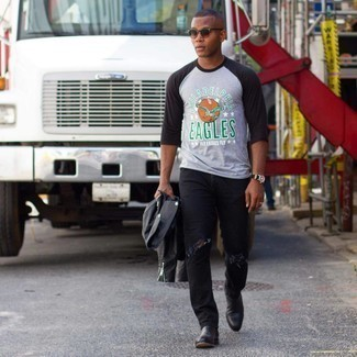 Charcoal Print Long Sleeve T-Shirt Outfits For Men: For a laid-back ensemble, consider teaming a charcoal print long sleeve t-shirt with black ripped jeans — these items go perfectly well together. A trendy pair of black leather chelsea boots is an easy way to bring an added dose of refinement to your ensemble.