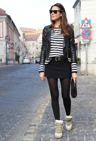 A black leather biker jacket and a black suede clutch are a great outfit formula to have in your arsenal. Beige suede wedge sneakers complement this ensemble very well. These picks will keep you comfortable and stylish in transitional weather.