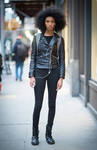 How to wear: black leather biker jacket, black long sleeve t-shirt, black skinny jeans, black leather lace-up flat boots