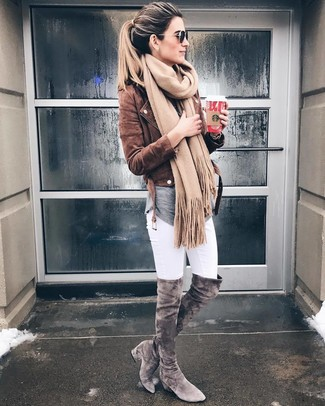 How to wear: brown suede biker jacket, grey long sleeve t-shirt, white skinny jeans, grey suede over the knee boots