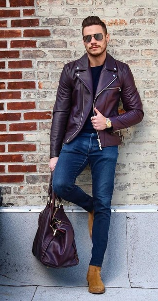 How to wear: burgundy leather biker jacket, black long sleeve t-shirt, navy skinny jeans, tobacco suede chelsea boots
