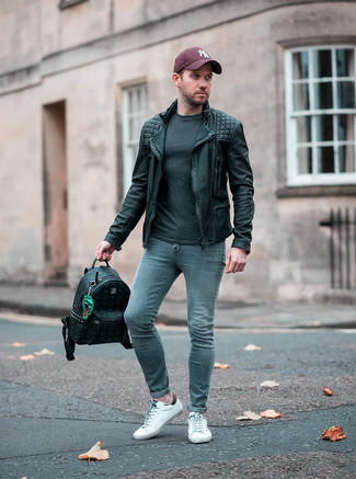 How to wear: black leather biker jacket, charcoal long sleeve t-shirt, grey skinny jeans, white leather low top sneakers