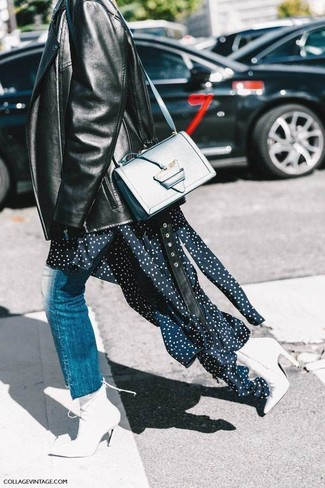 How to wear: black leather biker jacket, navy polka dot midi dress, blue jeans, white leather ankle boots