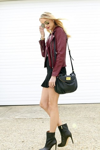 If you feel more confident in comfy clothes, you'll love this totally chic combination of a burgundy leather biker jacket and a black mini skirt. A cool pair of black leather ankle boots is an easy way to upgrade your look. So as you can see, it's so easy to look seriously stylish and stay toasty when cooler weather hits, all thanks to combos like this one.